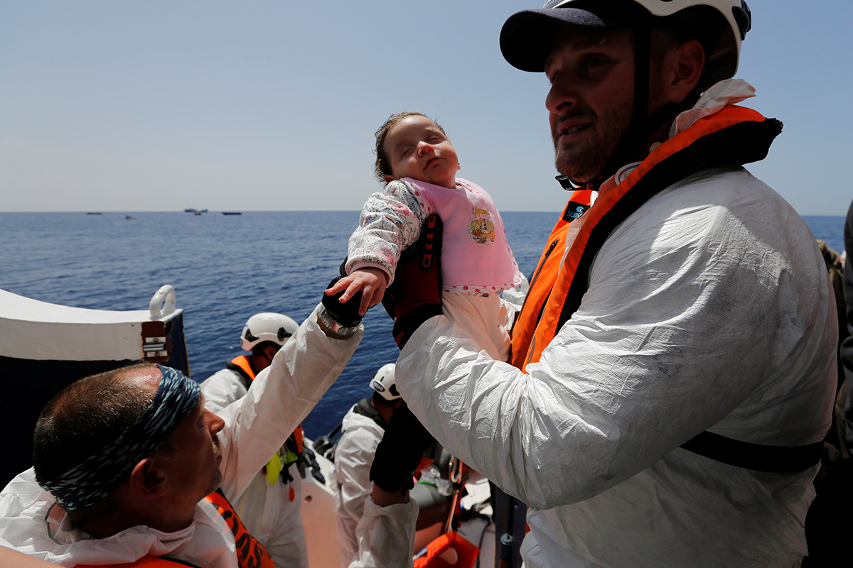 A baby migrant is brought onto the Malta-based NGO Migrant Offshore Aid Station (MOAS) ship Phoenix during a rescue operation in the central Mediterranean, in international waters off the Libyan coastal town of Sabratha, May 4, 2017. REUTERS/Darrin Zammit Lupi        TPX IMAGES OF THE DAY